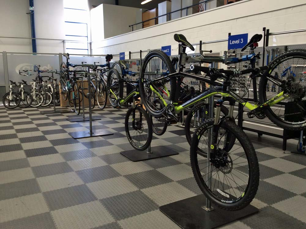 Bicycles on stands in a workshop