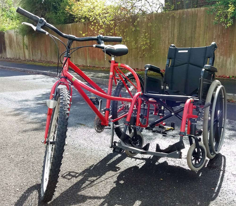 Cycle with Wheelchair attached to side