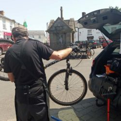 Rear of Man Fixing a Bicycle